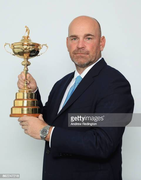 Thomas Bjorn of Denmark Captain of the Team Europe poses for a portrait with the Ryder Cup during the Ryder Cup 2018 Year to Go Captains Official...