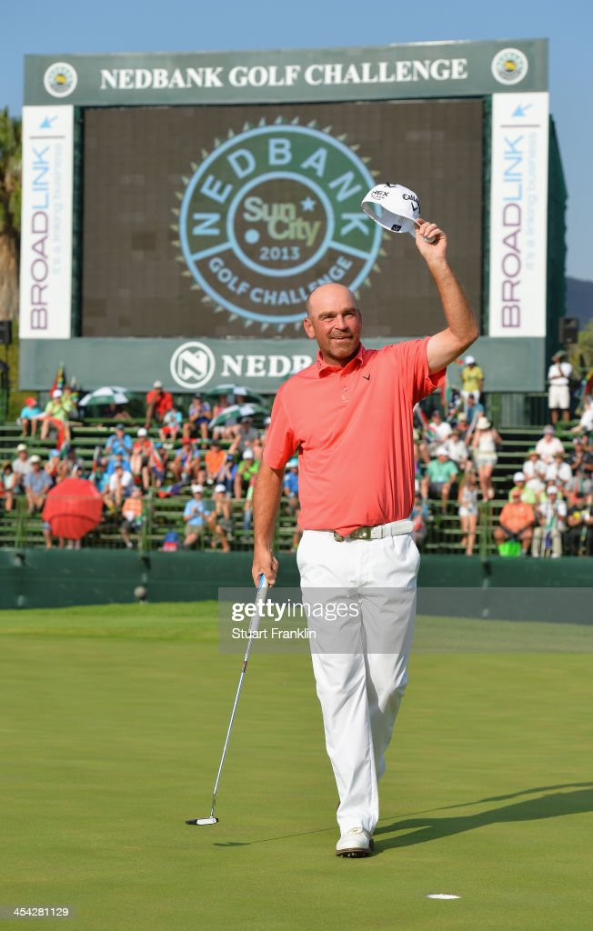 Thomas Bjorn of Denmark celebrates winning on the 18th hole during the final round of the Nedbank Golf Challenge at Gary Player CC on December 8, 2013 in Sun City, South Africa.