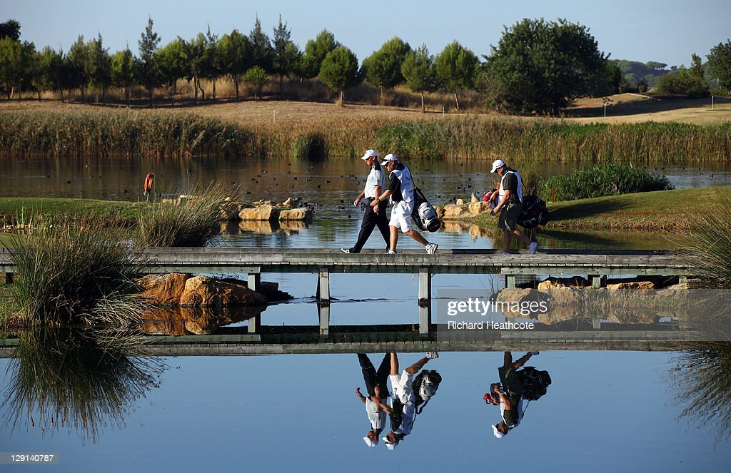 Thomas Bjorn of Denmark crosses a bridge to the 14th fairway during the first round the Portugal Masters at Oceanico Victoria Golf Course on October...