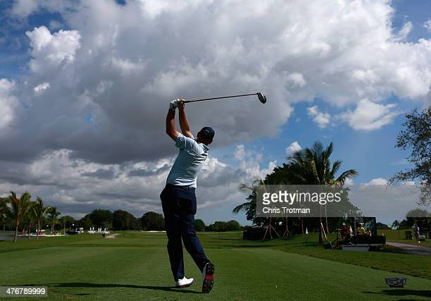 Thomas Bjorn of Denmark hits a shot during a practice round prior to the start of the World Golf ChampionshipsCadillac Championship at Trump National...