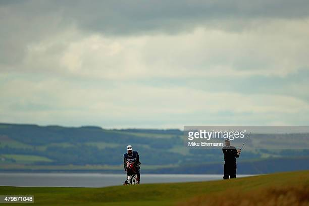 Thomas Bjorn of Denmark hits a shot on the ninth hole during the ProAm prior to the start of the Aberdeen Asset Management Scottish Open at Gullane...