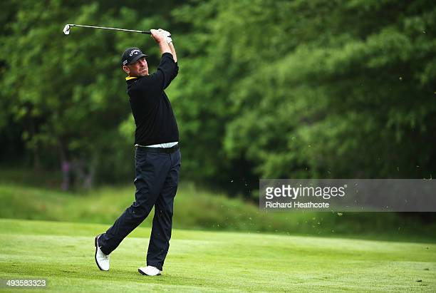 Thomas Bjorn of Denmark hits an approach during day three of the BMW PGA Championship at Wentworth on May 24 2014 in Virginia Water England
