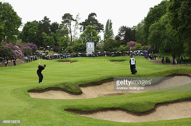 Thomas Bjorn of Denmark hits his 2nd shot on the 3rd hole during day three of the BMW PGA Championship at Wentworth on May 24 2014 in Virginia Water...