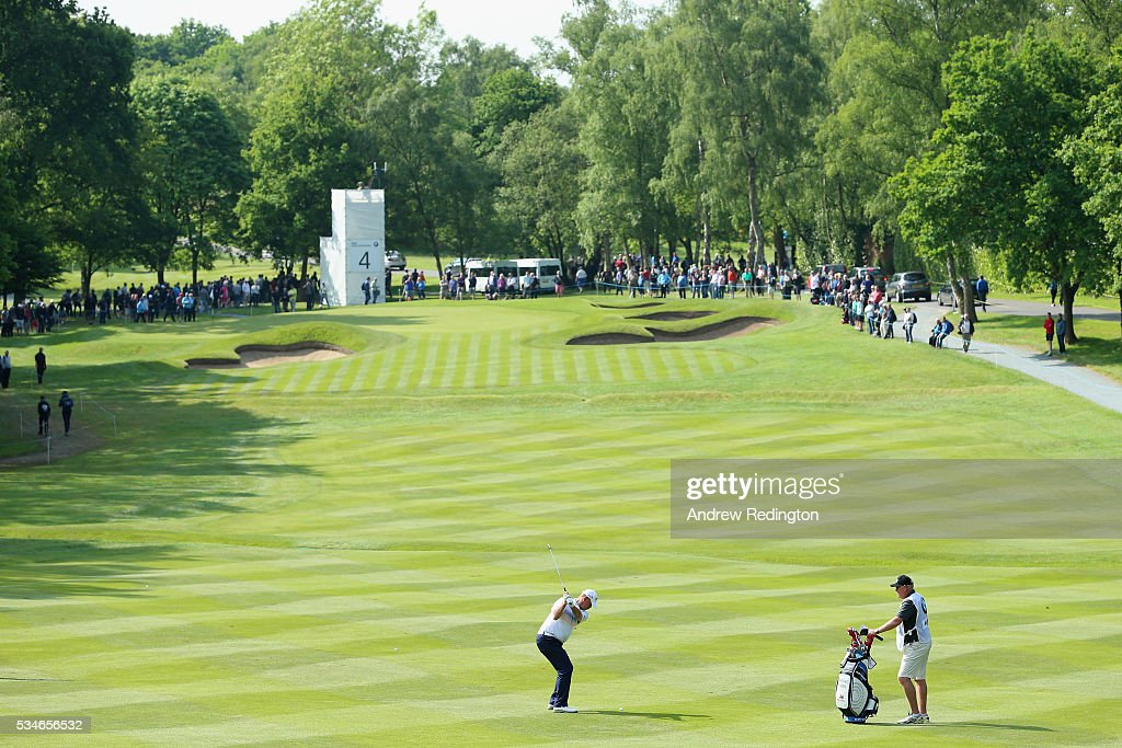 Thomas Bjorn of Denmark hits his 2nd shot on the 4th hole during day two of the BMW PGA Championship at Wentworth on May 27, 2016 in Virginia Water, England.