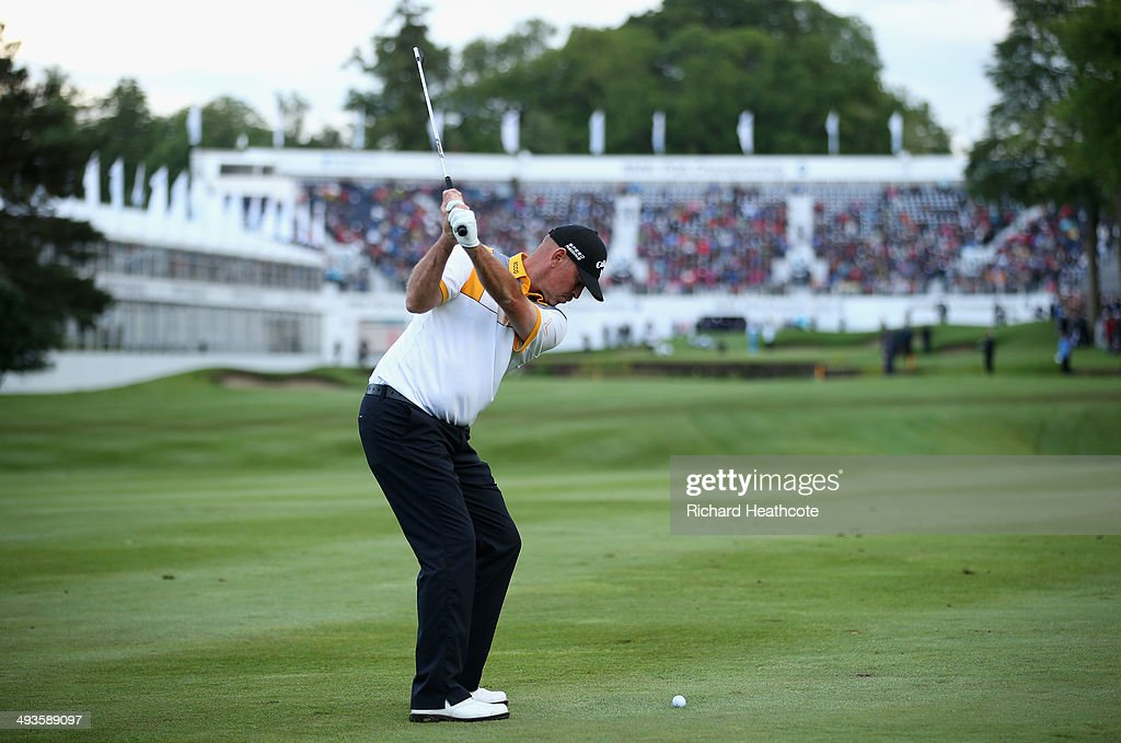 Thomas Bjorn of Denmark hits his 3rd shot on the 18th hole during day three of the BMW PGA Championship at Wentworth on May 24 2014 in Virginia Water...