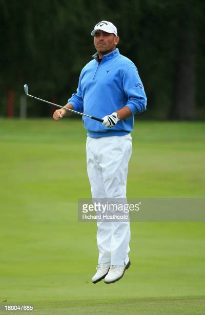 Thomas Bjorn of Denmark jumps up to look down the 15th fairway during the final round of the Omega European Masters at the CranssurSierre Golf Club...