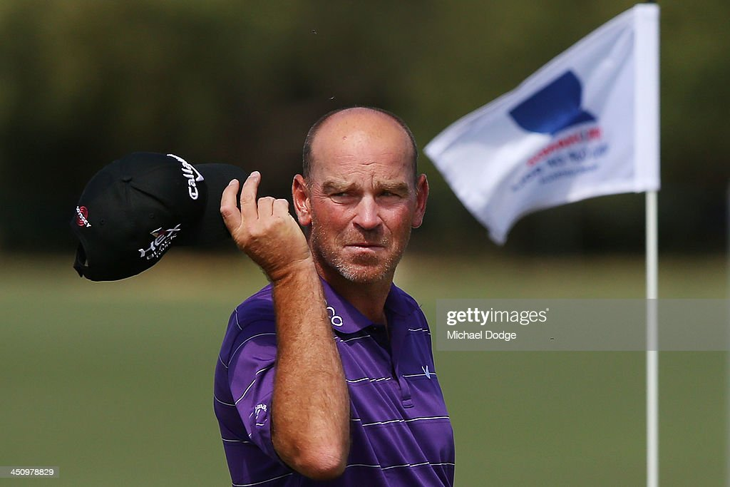 Thomas Bjorn of Denmark makes a birdie putt on the 18th hole during day one of the World Cup of Golf at Royal Melbourne Golf Course on November 21, 2013 in Melbourne, Australia.