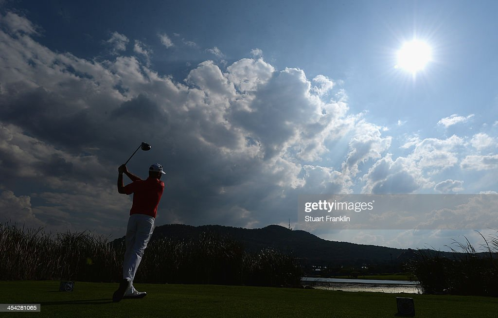 <a gi-track='captionPersonalityLinkClicked' href=/galleries/search?phrase=Thomas+Bjorn&family=editorial&specificpeople=202171 ng-click='$event.stopPropagation()'>Thomas Bjorn</a> of Denmark plays a shot during the final round of the Nedbank Golf Challenge at Gary Player CC on December 8, 2013 in Sun City, South Africa.