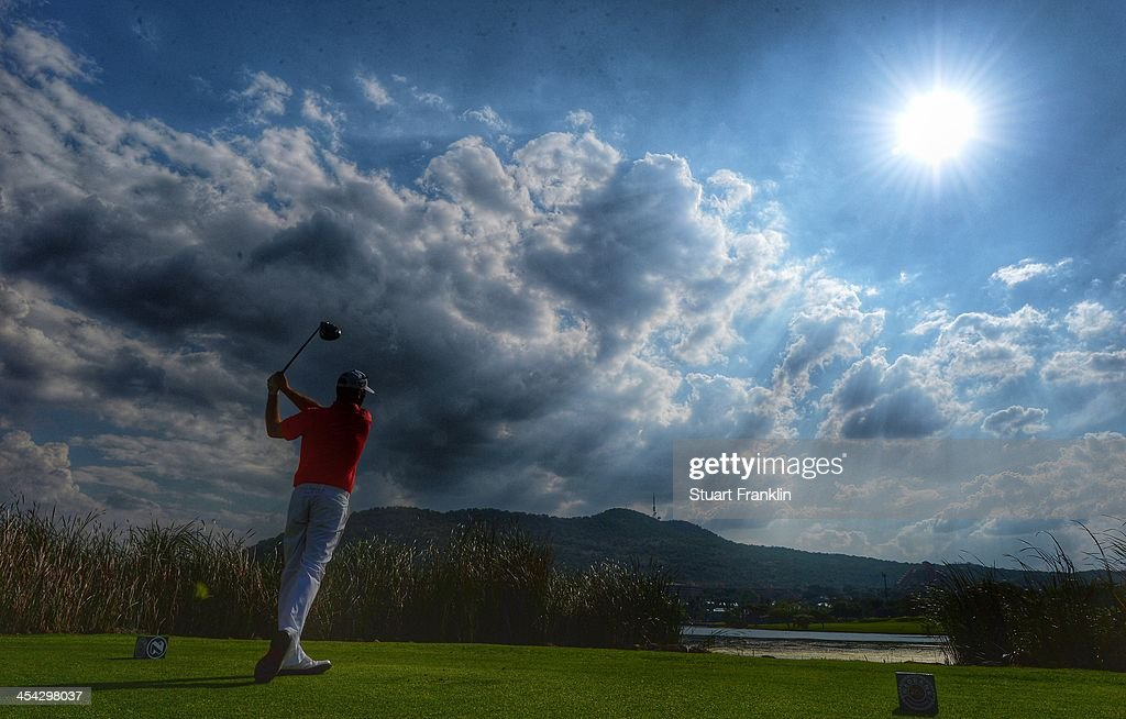 . Thomas Bjorn of Denmark plays a shot during the final round of the Nedbank Golf Challenge at Gary Player CC on December 8, 2013 in Sun City, South Africa.