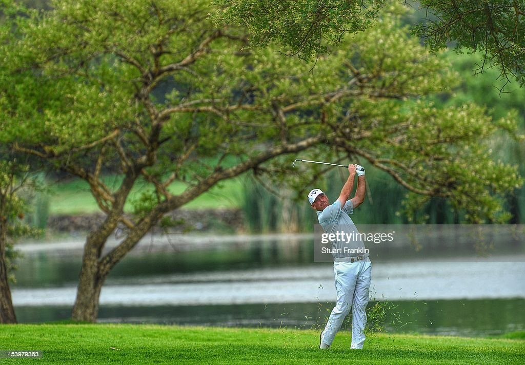 . Thomas Bjorn of Denmark plays a shot during the second round of the Nedbank Golf Challenge at Gary Player CC on December 6, 2013 in Sun City, South Africa.
