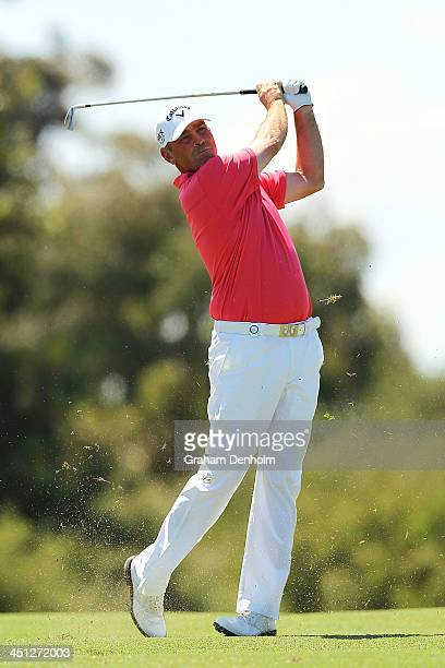 Thomas Bjorn of Denmark plays an approach shot during day two of the World Cup of Golf at Royal Melbourne Golf Course on November 22 2013 in...