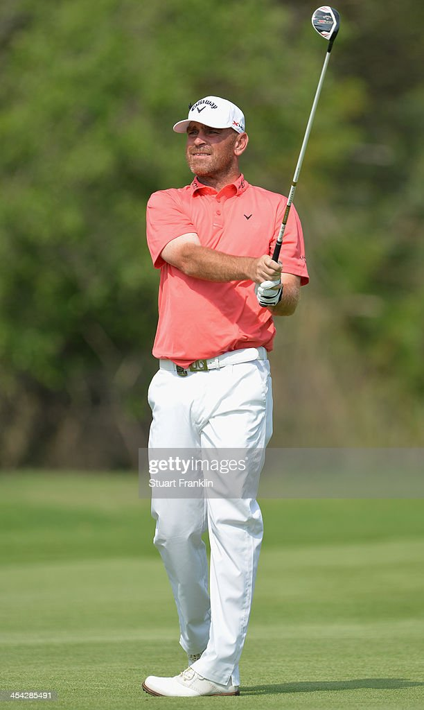 Thomas Bjorn of Denmark plays his approach shot on the 14th hole during the final round of the Nedbank Golf Challenge at Gary Player CC on December 8, 2013 in Sun City, South Africa.
