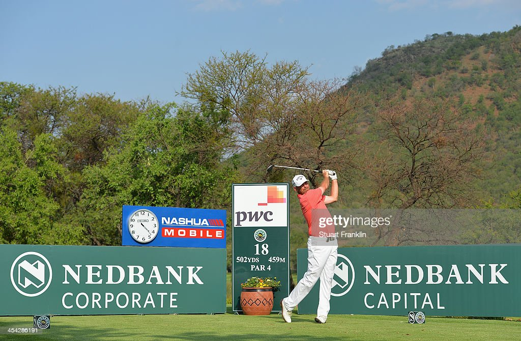 Thomas Bjorn of Denmark plays his tee shot on the 18th hole during the final round of the Nedbank Golf Challenge at Gary Player CC on December 8, 2013 in Sun City, South Africa.