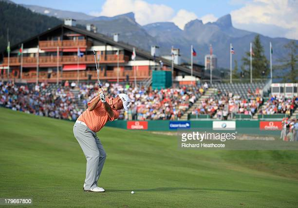 Thomas Bjorn of Denmark plays into the 18th green during the second round of the Omega European Masters at the CranssurSierre Golf Club on September...