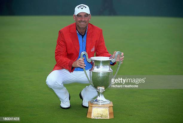 Thomas Bjorn of Denmark poses with the trophy after securing victory in a play off during the final round of the Omega European Masters at the...