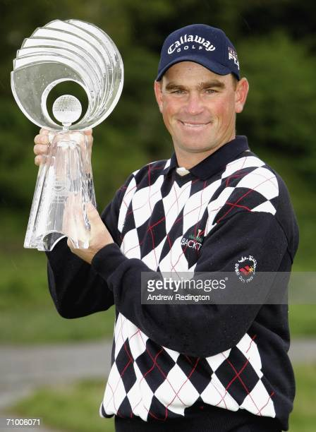 Thomas Bjorn of Denmark poses with the trophy after winning the Nissan Irish Open on The Montgomerie Course at Carton House Golf Club on May 22 2006...