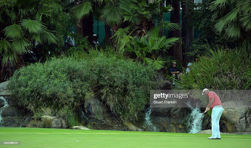 Thomas Bjorn of Denmark putts during the final round of the Nedbank Golf Challenge at Gary Player CC on December 8, 2013 in Sun City, South Africa.