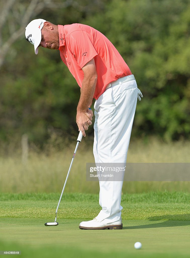 Thomas Bjorn of Denmark putts on the 14th hole during the final round of the Nedbank Golf Challenge at Gary Player CC on December 8, 2013 in Sun City, South Africa.