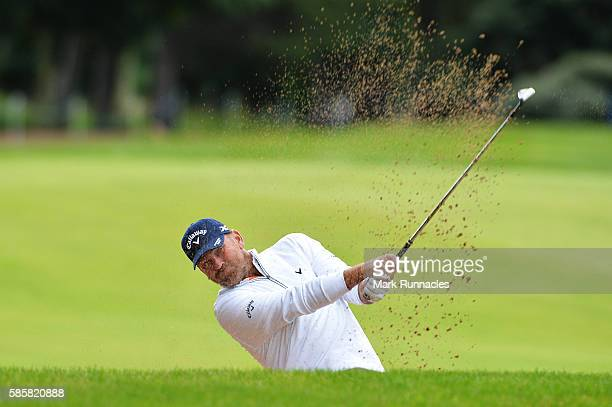 Thomas Bjorn of Denmark takes a bunker shot on hole 9 on day one of the Aberdeen Asset Management Paul Lawrie Matchplay at Archerfield Links Golf...