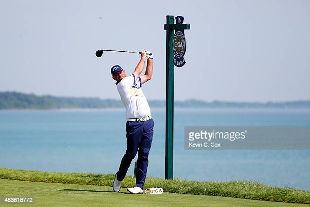 Thomas Bjorn of Denmark watches his tee shot on the 16th hole during the first round of the 2015 PGA Championship at Whistling Straits on August 13...