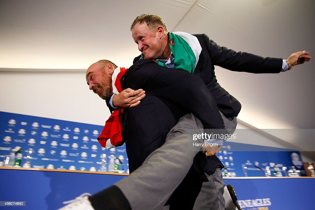 Thomas Bjorn of Europe carries Jamie Donaldson into the press conference after the Singles Matches of the 2014 Ryder Cup on the PGA Centenary course at the Gleneagles Hotel on September 28, 2014 in Auchterarder, Scotland.