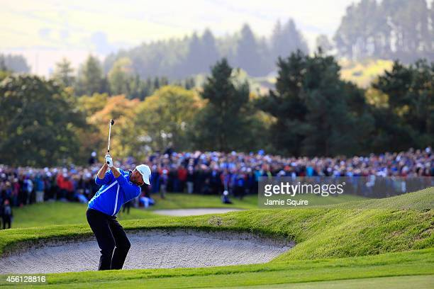 Thomas Bjorn of Europe plays his second shot on the 16th hole during the Morning Fourballs of the 2014 Ryder Cup on the PGA Centenary course at the...