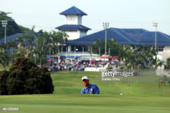 Thomas Bjorn of Team Europe in action during the singles draw matches against Team Asia during day three of the EurAsia Cup at Glenmarie GCC on March...
