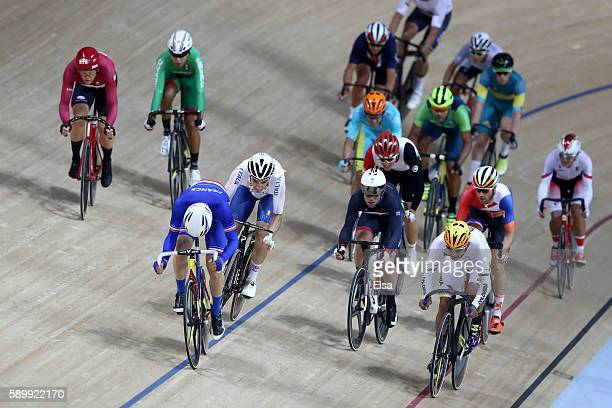 Thomas Boudat of France Fernando Gaviria Rendon of Colombia and Elia Viviani of Italy compete in the Cycling Track Men's Omnium Points Race 66 on Day...