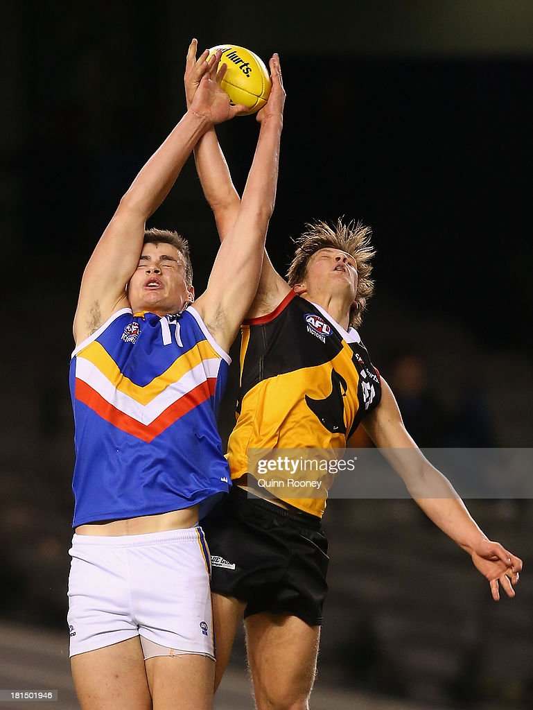 Thomas Boyd of the Ranges marks infront of Joshua Newman of the Stingrays during the TAC Cup final match between Eastern Ranges and the Dandenong Southern Stingrays at Etihad Stadium on September 22, 2013 in Melbourne, Australia.