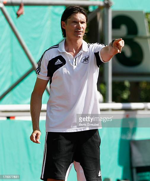 Thomas Brdaric head coach of Neustrelitz gestures during the DFB Cup first round match between TSG Neustrelitz and SC Freiburg at Parkstadion on...
