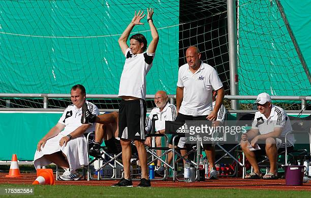 Thomas Brdaric head coach of Neustrelitz reacts during the DFB Cup first round match between TSG Neustrelitz and SC Freiburg at Parkstadion on August...