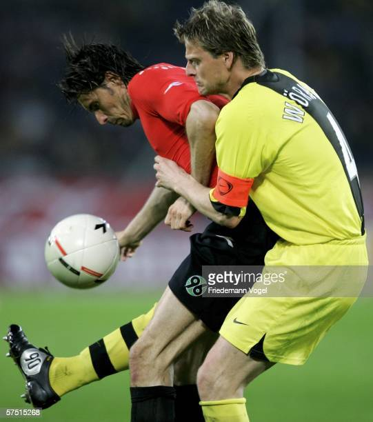 Thomas Brdaric of Hanover challenges for the ball with Christian Woerns of Dortmund during the Bundesliga match between Hanover 96 and Borussia...
