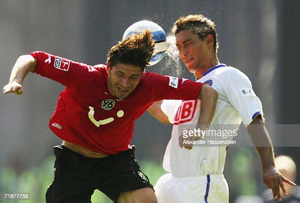 Thomas Brdaric of Hanover challenges for the ball with Malik Fathi of Berlin during the Bundesliga match between Hertha BSC Berlin and Hanover 96 at...