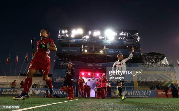 Thomas Briels of Belgium and Mats Grambusch of Germany lead their teams out during day 9 of the FIH Hockey World League Men's Semi Finals final match...