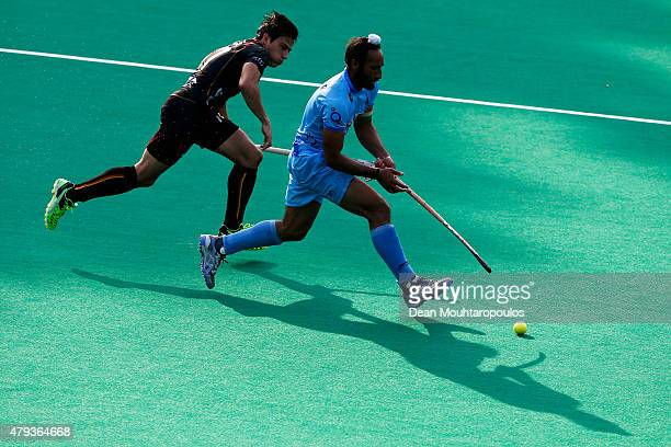 Thomas Briels of Belgium and Sardar Singh of India battle for the ball uring the Fintro Hockey World League SemiFinal match between India and Belgium...