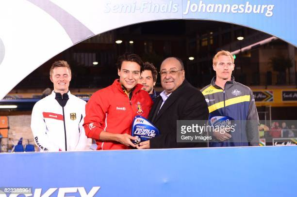 Thomas Briels of Belgium receives the trophy from FIH Executive Board Member and President of the African Hockey Federation Seif Ahmed during day 9...