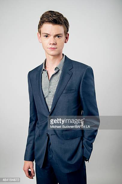 Thomas Brodie Sangster poses for a portrait at the BAFTA Tea Party on August 23 2014 on August 23 2014 in Los Angeles California