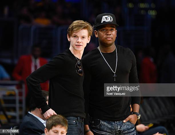Thomas BrodieSangster and Dexter Darden attend a basketball game between the Memphis Grizzlies and the Los Angeles Lakers at Staples Center on March...