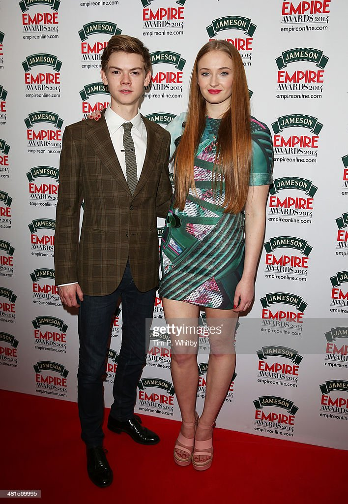 Thomas Brodie-Sangster and Sophie Turner pose during the Jameson Empire Awards 2014 at the Grosvenor House Hotel on March 30, 2014 in London, England. Regarded as a relaxed end to the awards show season, the Jameson Empire Awards celebrate the film industry's success stories of the year with winners being voted for entirely by members of the public. Visit empireonline.com/awards2014 for more information.
