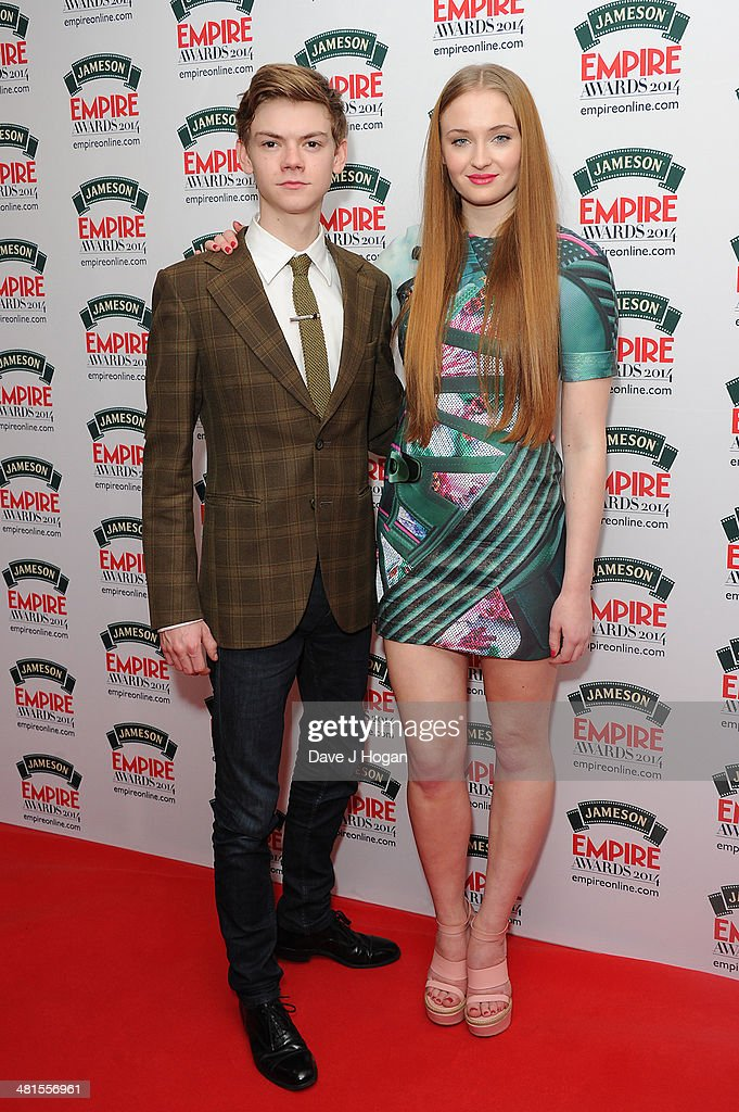 Thomas Brodie-Sangster and Sophie Turner poses in the press room at the Jameson Empire Film Awards 2014 at The Grosvenor House Hotel on March 30, 2014 in London, England.