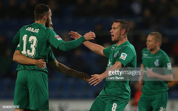 Thomas Broecker of Duisburg celebrates after scoring his teams first goal during the Second Bundesliga match between Arminia Bielefeld and MSV...