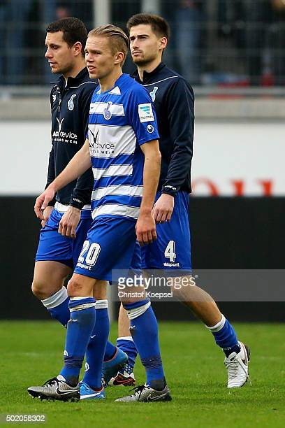 Thomas Broeker Dennis Grote and Dustin Bomheuer of Duisburg look dejected after the Second Bundesliga match between MSV Duisburg and VfL Bochum at...