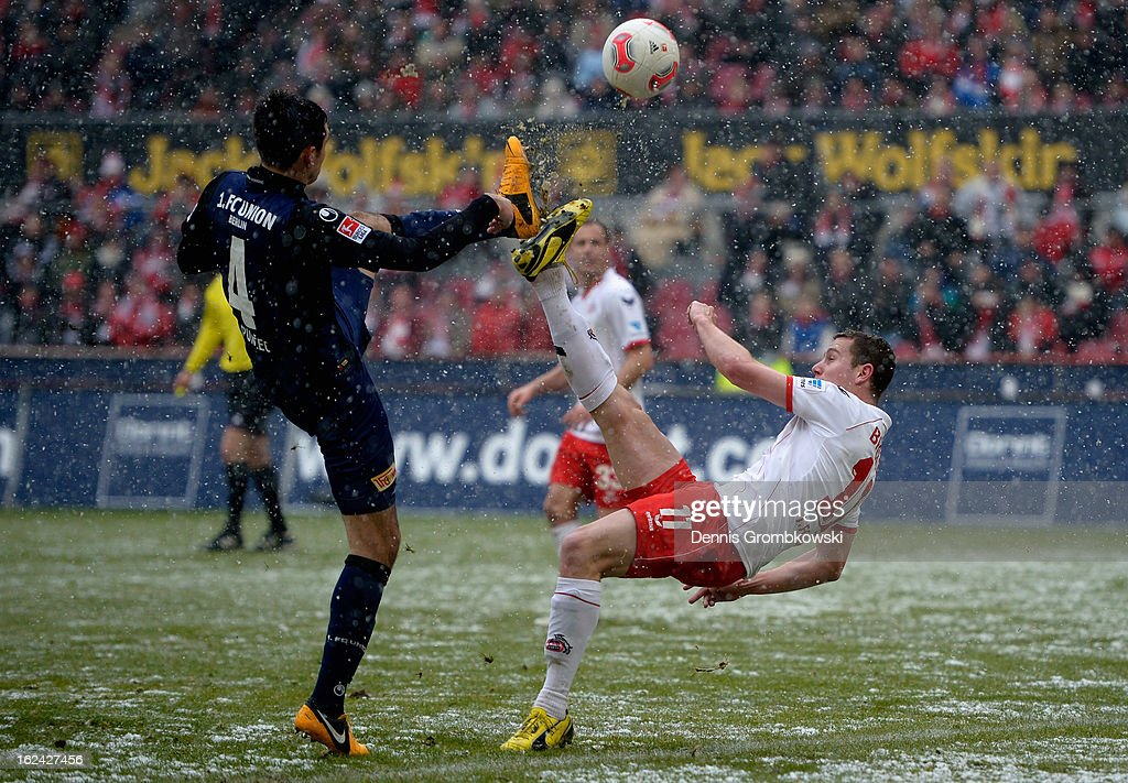 Thomas Broeker of Cologne misses a chance at goal under the pressure of Roberto Puncec of Berlin during the Second Bundesliga match between 1. FC Koeln and Union Berlin at RheinEnergieStadion on February 23, 2013 in Cologne, Germany.