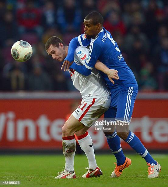 Thomas Broeker of Keoln is challenged by Felipe Santana of Schalke during a test match between 1 FC Koeln and FC Schalke 04 at RheinEnergieStadion on...