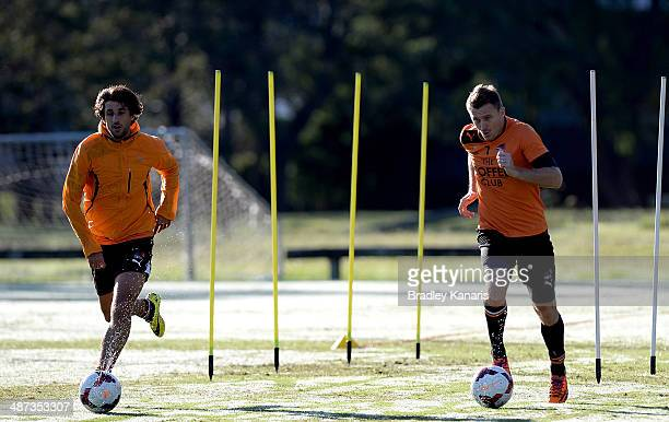 Thomas Broich and Besart Berisha perform training drills during a Brisbane Roar ALeague training session at Ballymore Stadium on April 30 2014 in...