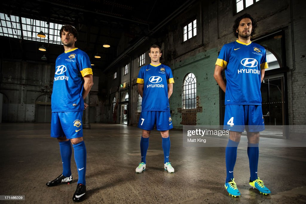 Thomas Broich, Brett Emerton and Nikolai Topor-Stanley pose during the A-League All Stars jersey launch at Carriageworks on June 25, 2013 in Sydney, Australia.
