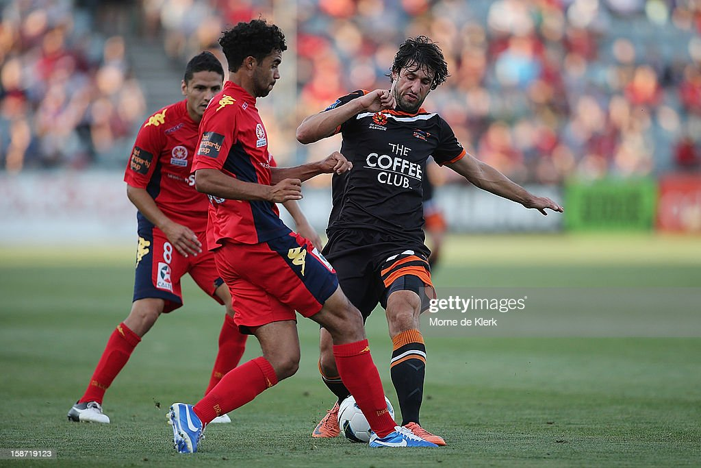 <a gi-track='captionPersonalityLinkClicked' href=/galleries/search?phrase=Thomas+Broich&family=editorial&specificpeople=676225 ng-click='$event.stopPropagation()'>Thomas Broich</a> of Brisbane is tackled by Osama Malik of Adelaide during the round 13 A-League match between Adelaide United and the Brisbane Roar at Hindmarsh Stadium on December 26, 2012 in Adelaide, Australia.