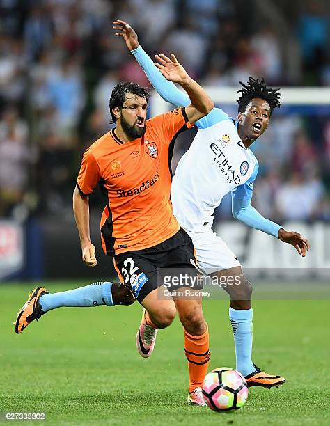 Thomas Broich of Brisbane Roar and Bruce Kamau of the City compete for the ball during the round nine ALeague match between Melbourne City FC and the...