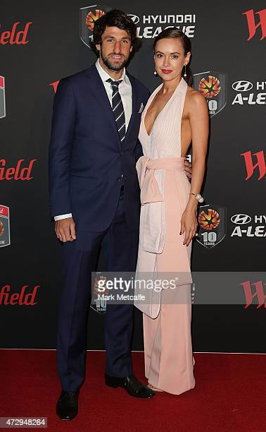 Thomas Broich of Brisbane Roar and Helena Blech arrive ahead of the ALeague WLeague 2014/15 Awards Night at Carriageworks on May 11 2015 in Sydney...