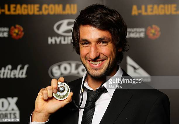 Thomas Broich of Brisbane Roar poses with the 2012 ALeague Johnny Warren Medal at Doltone House Darling Island Wharf on April 10 2012 in Sydney...